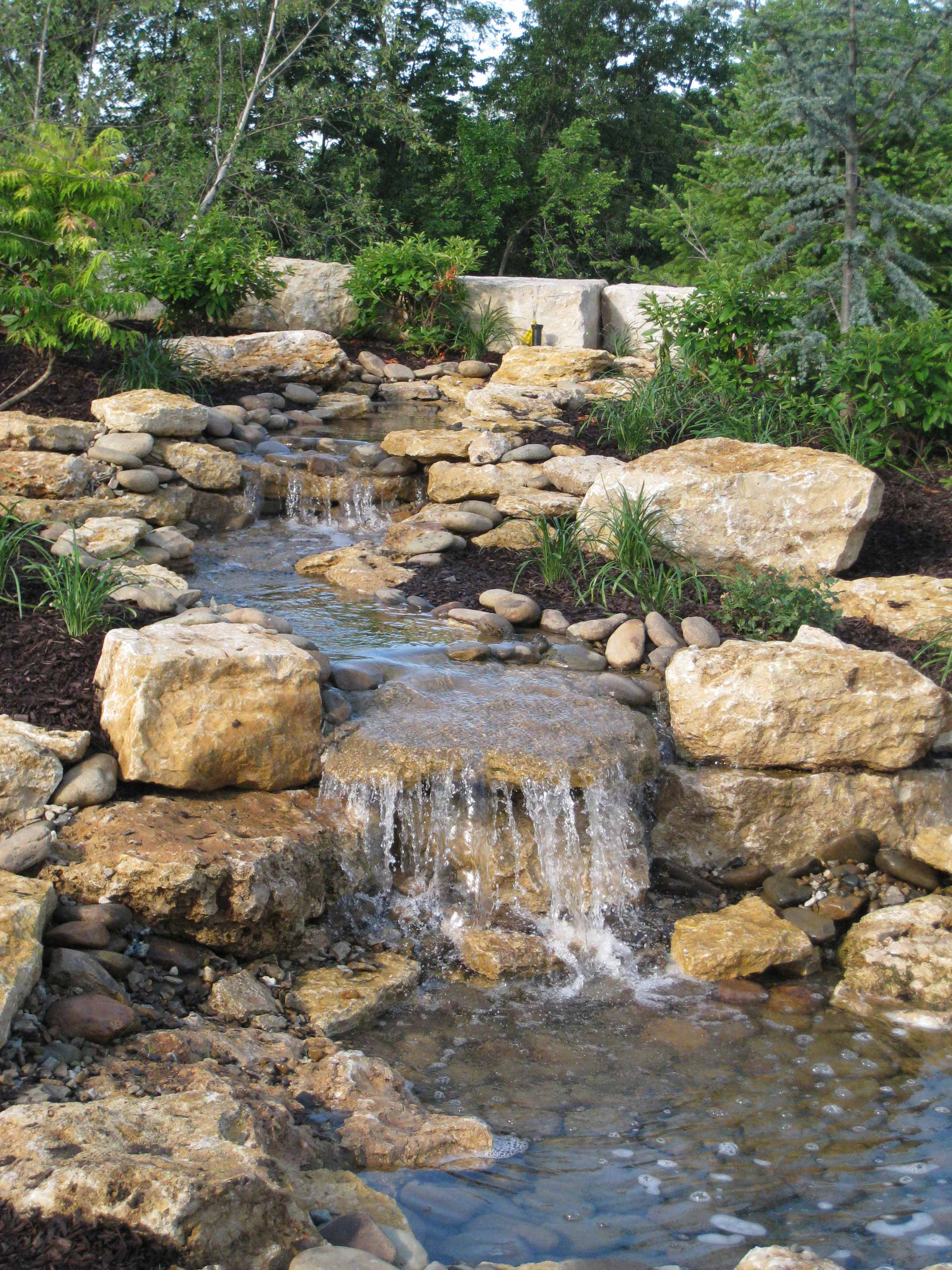 Water feature design installation in kansas city for Garden waterfall fountain